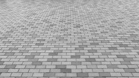 Vue de perspective de Gray Brick Stone Street Road monotone Trottoir, texture de trottoir Image stock