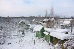 Vue des complots de jardin en hiver Images libres de droits