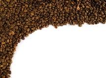 Vue des grains de café sur un fond blanc Photographie stock