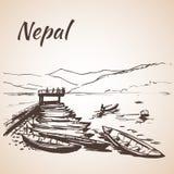 Vue du Népal avec l'eau et beaucoup de bateaux Photographie stock libre de droits