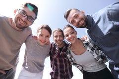 Vue inférieure équipe créative réussie d'affaires regardant le camer photo libre de droits