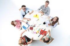 Vue supérieure d'équipe d'affaires sur le fond d'espace de travail Image stock