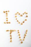 Vue supérieure de l'amour TV d'I fait de maïs éclaté Photo libre de droits