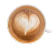 Vue supérieure de la mousse chaude de forme de coeur d'art de latte de café d'isolement sur le wh Photos libres de droits