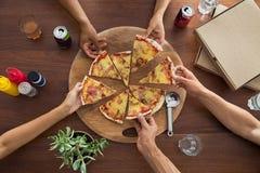 Vue supérieure de partie de pizza Photos stock