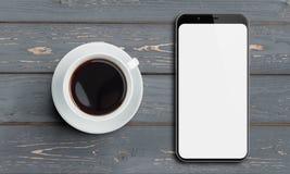 Vue supérieure de Smartphone et tasse de café sur la vieille table en bois Photos stock