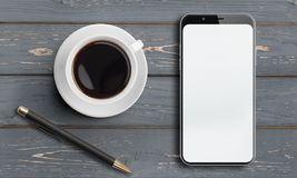 Vue supérieure de Smartphone sur la vieille table en bois avec le stylo et le café Image stock