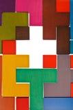 Vue supérieure de trou croisé de forme dans le puzzle Photos libres de droits