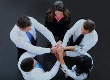 Vue supérieure des gens d'affaires avec leurs mains ensemble en cercle Images stock