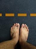 Vue supérieure, support de pied sur la couche de surface Images libres de droits