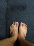 Vue supérieure, support de pied sur la couche de surface Photographie stock
