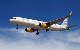 Vueling Airbus A321. A Vueling Airbus A321 approaching to El Prat Airport in Barcelona, Spain Royalty Free Stock Photos