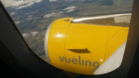 Vueling aircraft logotype on jet turbine stock video footage