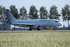 Vueling Aircraft taxiing in Amsterdam Airport AMS. Schiphol stock images