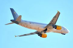 Vueling airline airbus a 320 model of airplane in sky fllying maniobre of aproximation to the airport Royalty Free Stock Image