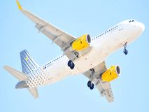Vueling airline airbus model flight over blue sky Royalty Free Stock Photos