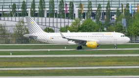 Vueling jet doing taxi in Munich Airport, MUC