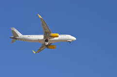 Vueling Passenger Plane, Aircraft Flying Overhead Royalty Free Stock Images