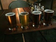 Vuelo de la cerveza del arte de un Microbrewery foto de archivo