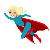 Vuelo de la muchacha del superhéroe Imagen de archivo libre de regalías