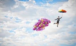 Vuelo de la mujer en el paraguas Imagen de archivo