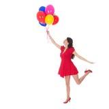 Vuelo de la mujer joven con los globos Imágenes de archivo libres de regalías