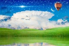 Vuelo del globo del aire caliente en cielo estrellado a la Luna Nueva
