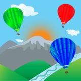 Vuelo del globo del aire caliente sobre paisaje de la montaña Imagen de archivo libre de regalías
