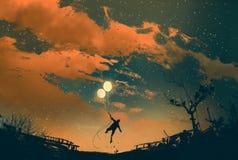 Vuelo del hombre con las luces del globo en la puesta del sol Fotos de archivo libres de regalías