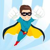 Vuelo del hombre del super héroe Foto de archivo