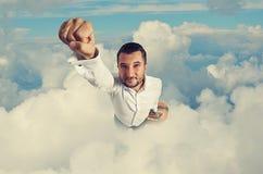 Vuelo del hombre a través de las nubes Fotografía de archivo libre de regalías