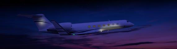Vuelo del jet privado en la noche Fotos de archivo