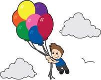 Vuelo del muchacho con los globos Imágenes de archivo libres de regalías
