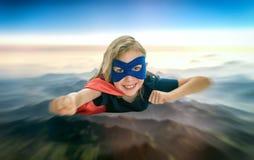 Vuelo del niño del super héroe Foto de archivo libre de regalías
