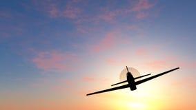 Vuelo en una puesta del sol Foto de archivo libre de regalías