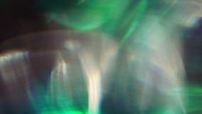 Vuelo ligero abstracto Defocused de las formas ca?tico en espacio Tonalidad verde metrajes