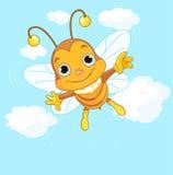 Vuelo lindo de la abeja en el cielo Imágenes de archivo libres de regalías