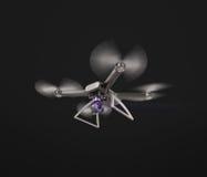 Vuelo teledirigido moderno del abejón del aire con la cámara de la acción En fondo negro 3d Foto de archivo libre de regalías