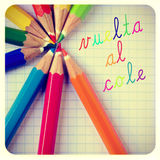 Vuelta al cole, back to school written in spanish. And some pencil crayons of different colors on a notebook, with a frame and a retro effect Stock Photos