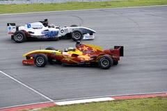 Vuelta del coche de carreras de A1GP y acción evasiva Imágenes de archivo libres de regalías