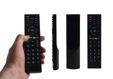 3 vues différentes d'à télécommande noir d'isolement sur le dos de blanc Image stock
