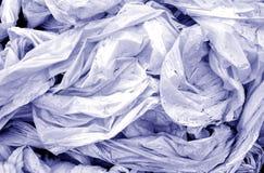 Vuil verfrommeld pvc in blauwe toon royalty-vrije stock foto's