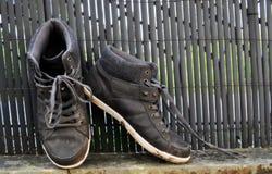 Vuile arbeiders` s schoenen Royalty-vrije Stock Foto's