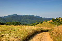 Vuile Weg op Heuvels Stock Afbeelding