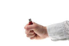 Vuist in bedrijfsoverhemd dat een stok USB houdt royalty-vrije stock afbeelding