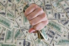 Vuist met dollarrekeningen Stock Afbeelding