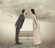 Vuist tonen en vrouw die neer kijken Royalty-vrije Stock Afbeelding