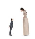 Vuist tonen en vrouw die neer kijken Royalty-vrije Stock Foto's