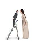 Vuist tonen en vrouw die neer kijken Stock Afbeeldingen