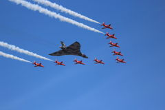 Vulcan Bomber and Red Arrows Royalty Free Stock Photo
